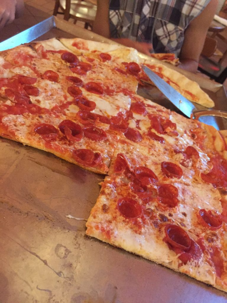 Tray of pepperoni pizza from Via Napoli at Disney's Epcot for a magical birthday at Disney