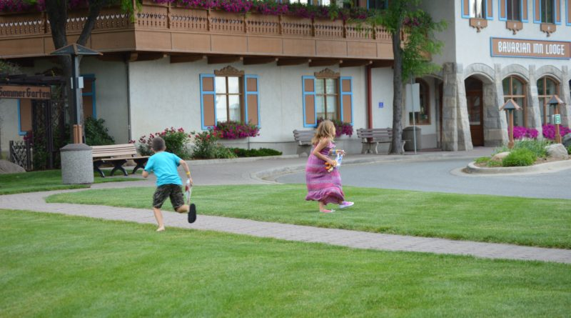 kids running and jumping in grass