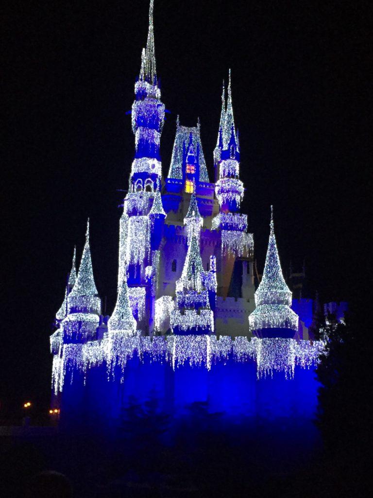 Magic Kingdom Cinderella Castle  lit up at Christmas while hotel hopping