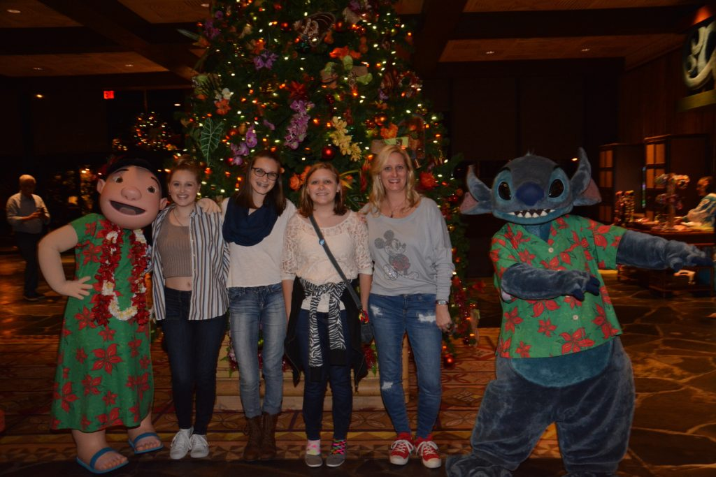 Photopass with Lilo and Stitch at Polynesian Resort in front of Christmas tree