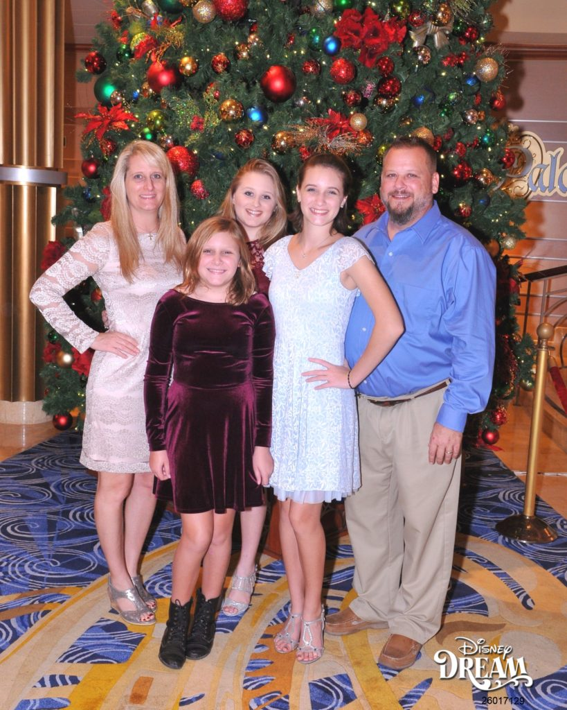Family in front of Christmas tree on Disney Dream