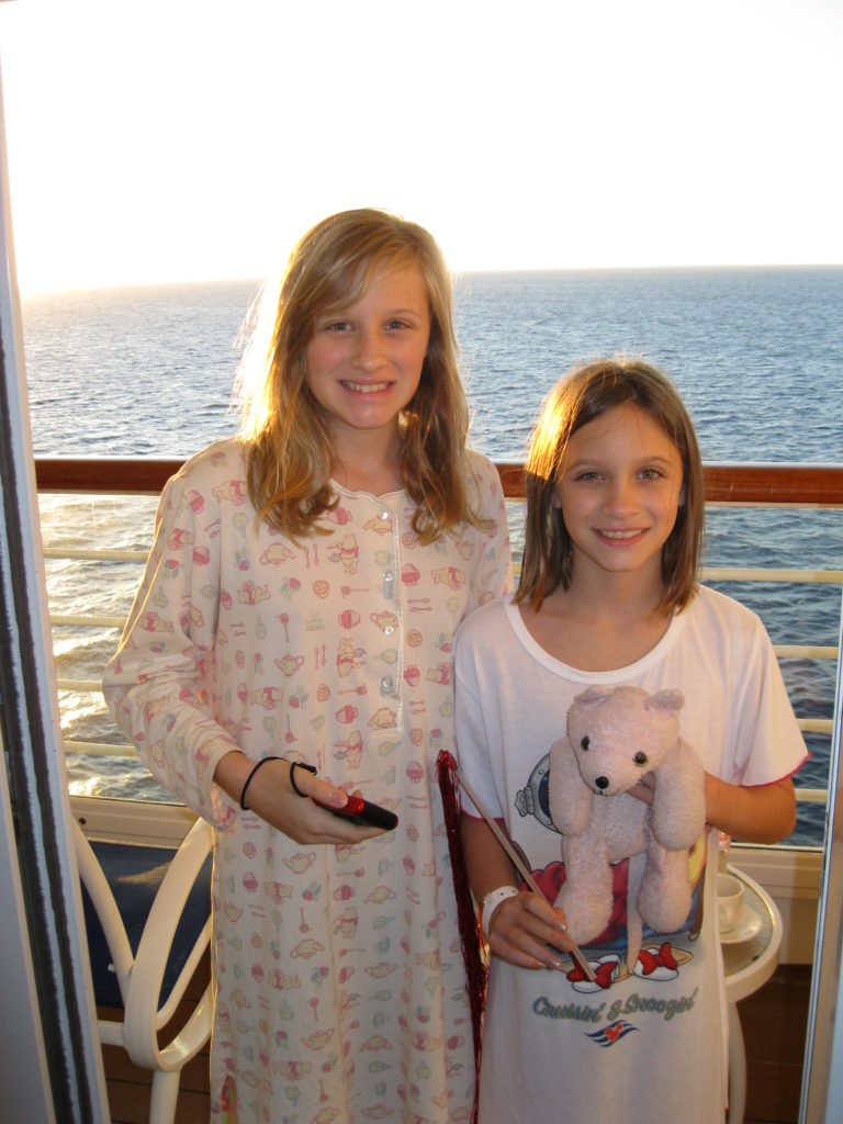 Girls standing on cruise ship balcony