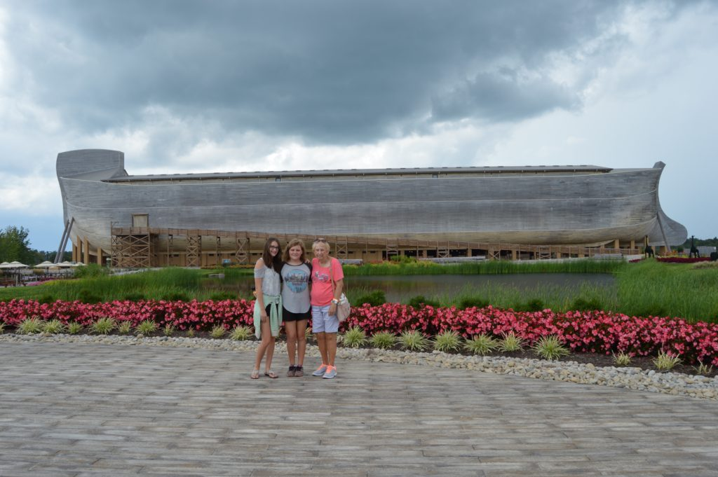 teens with grandparent in front of Ark Encounter