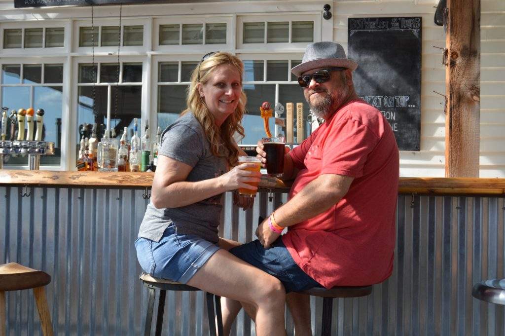 Couple sitting at outdoor bar of Bird Creek Farms, places to visit in Michigan's Thumb