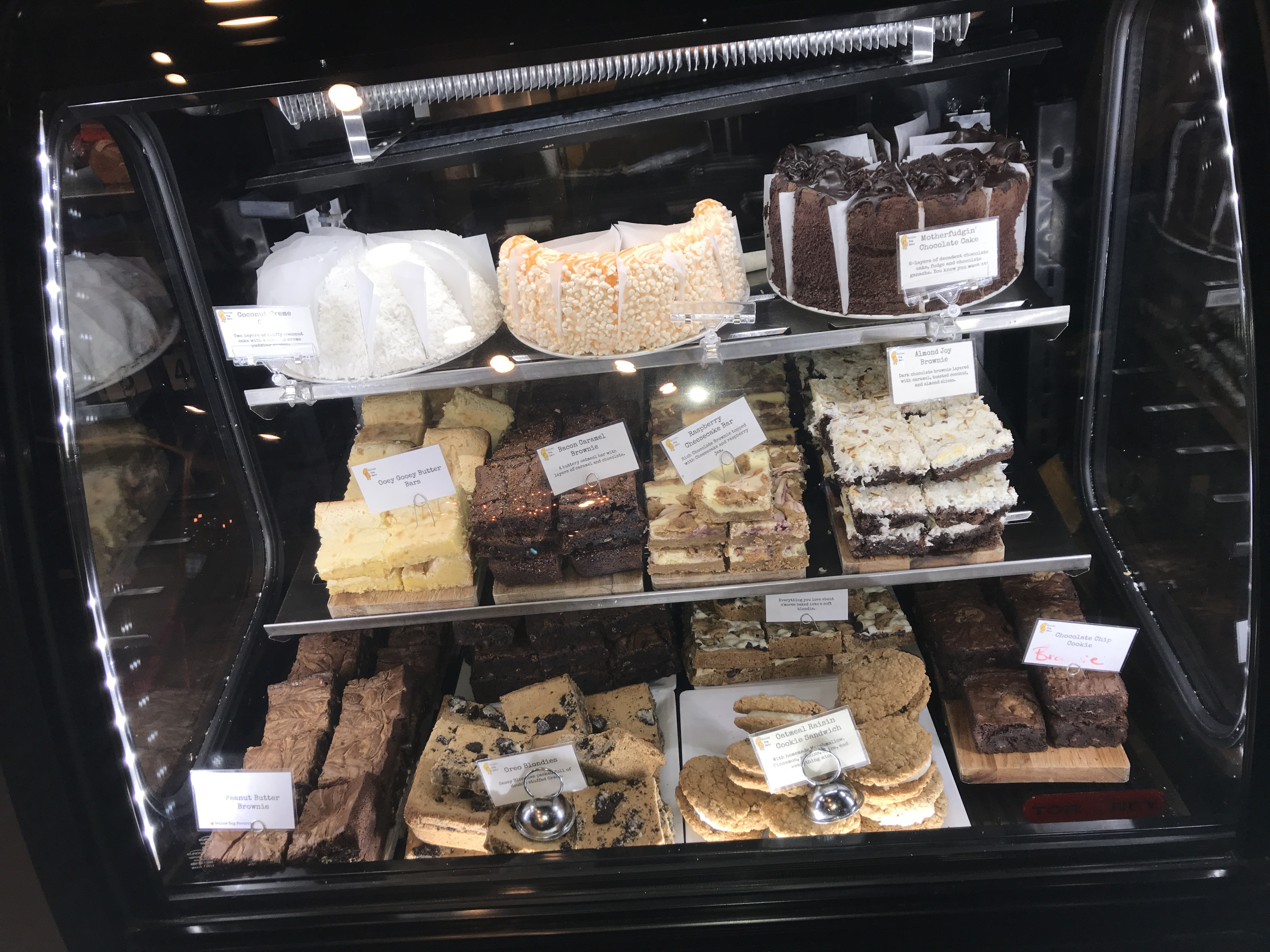 deli display filled with baked goods