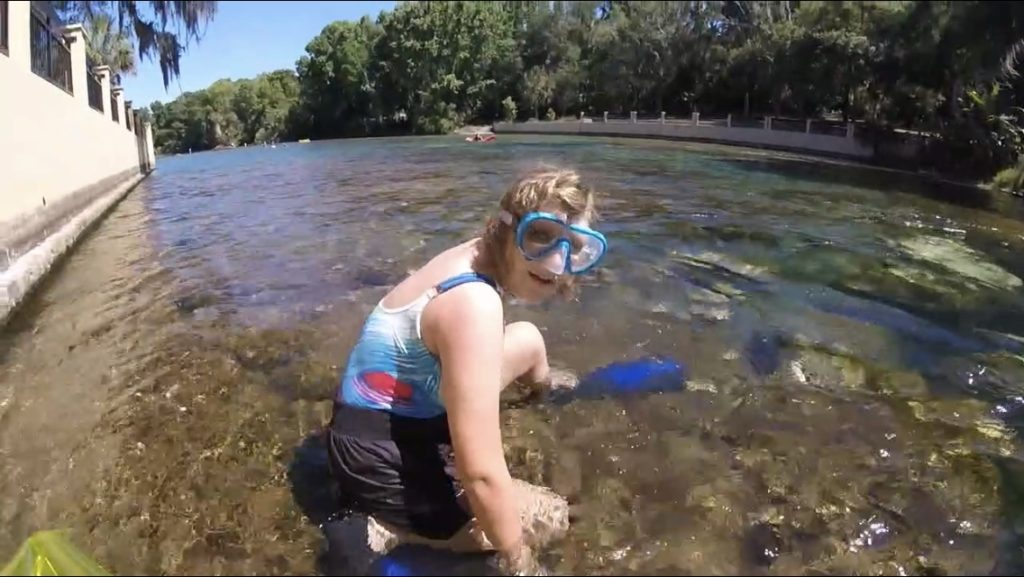 snorkeling girl heading into water