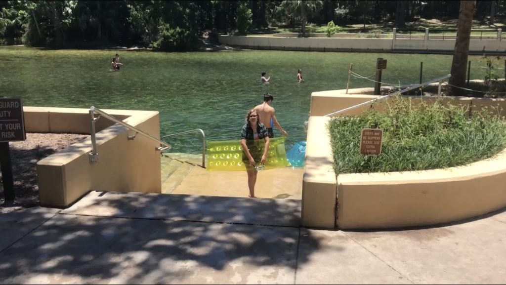 girl standing on stairway into snorkeling area