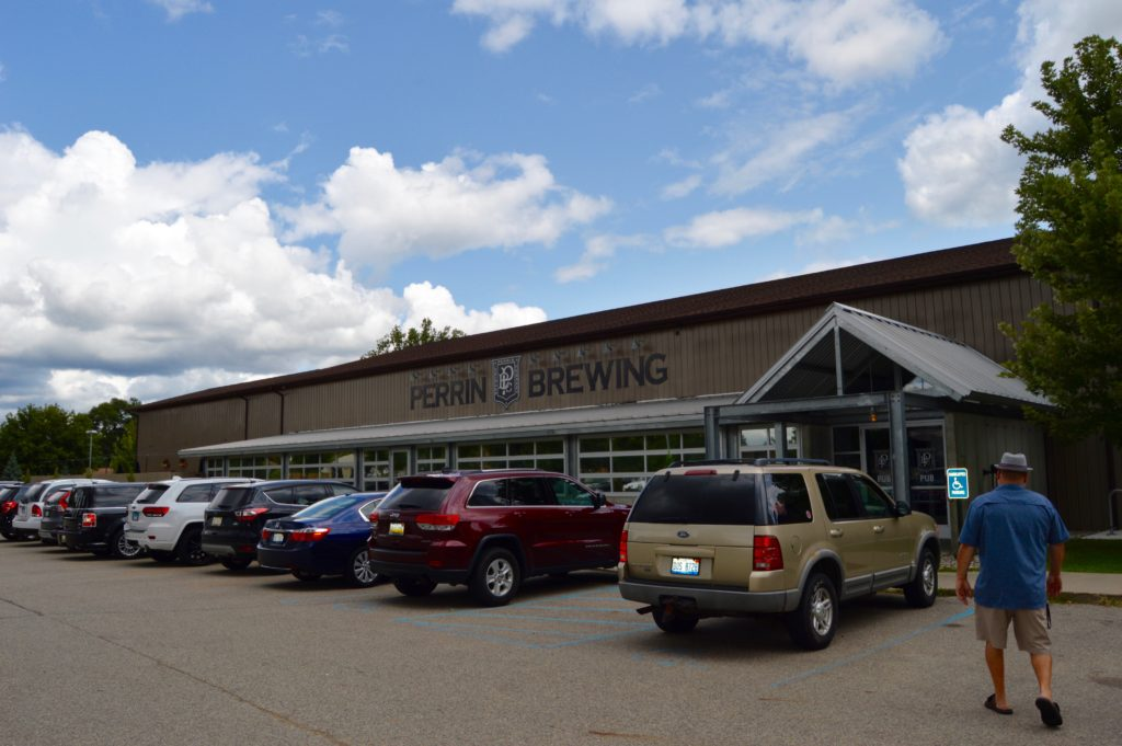 Man walking into Perrin Brewing in Beer City, USA