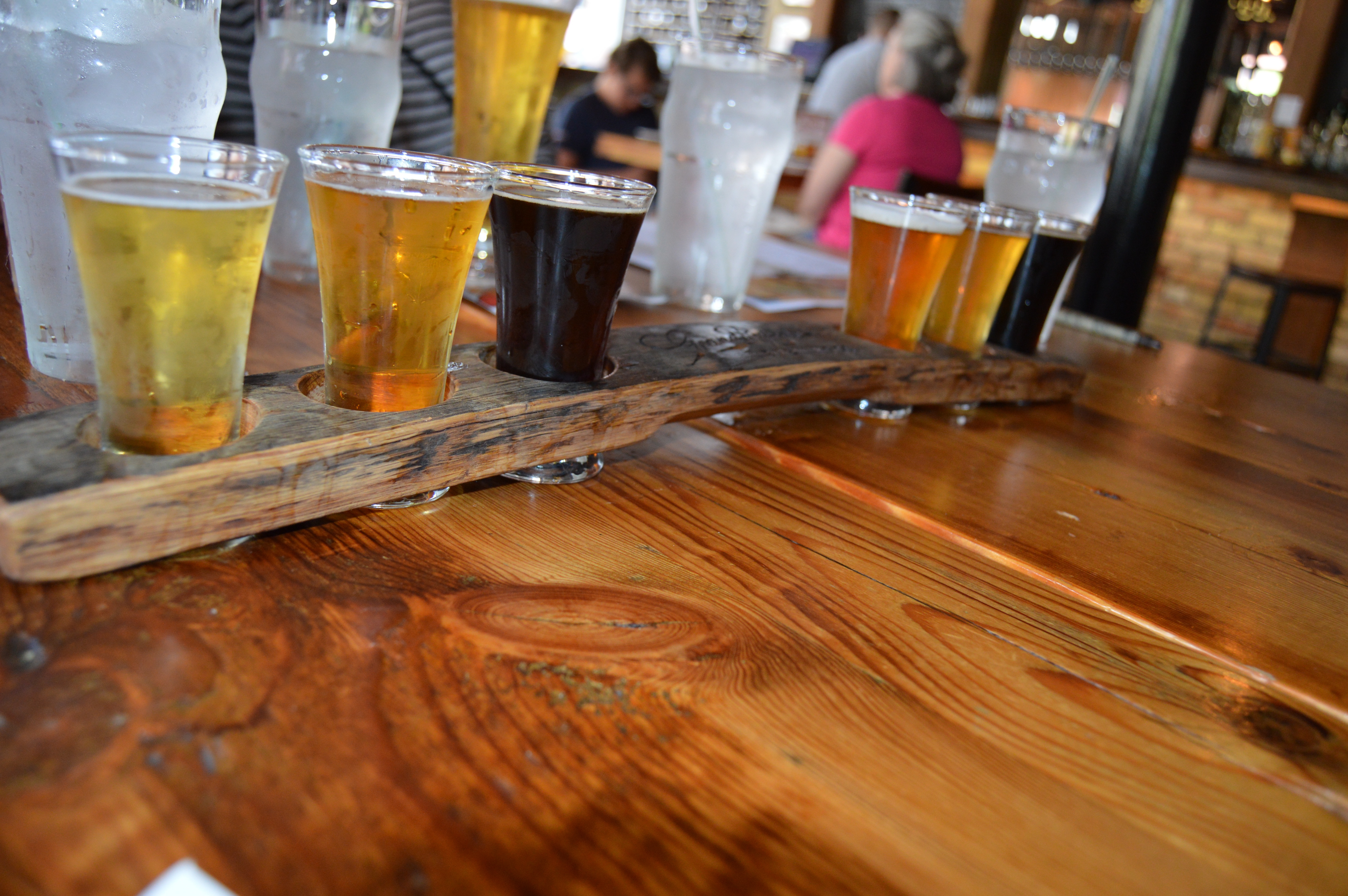 Flight of beer in reclaimed wood holder at Grand Rapids Brewing in Beer City, USA