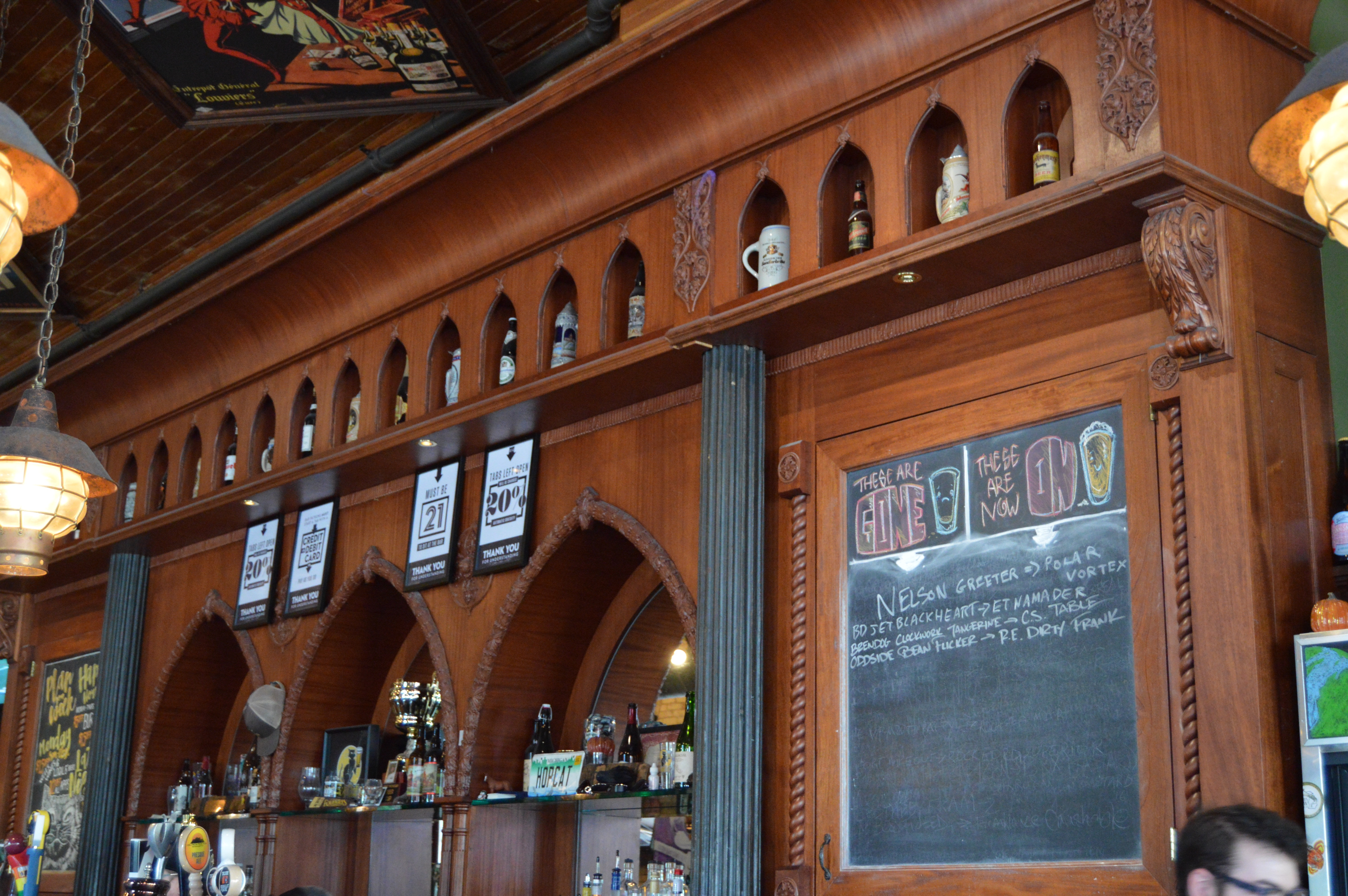 Old, restored detailed wood bar at HopCat in Grand Rapids, Michigan