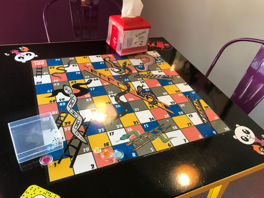 table top with snakes & ladders game