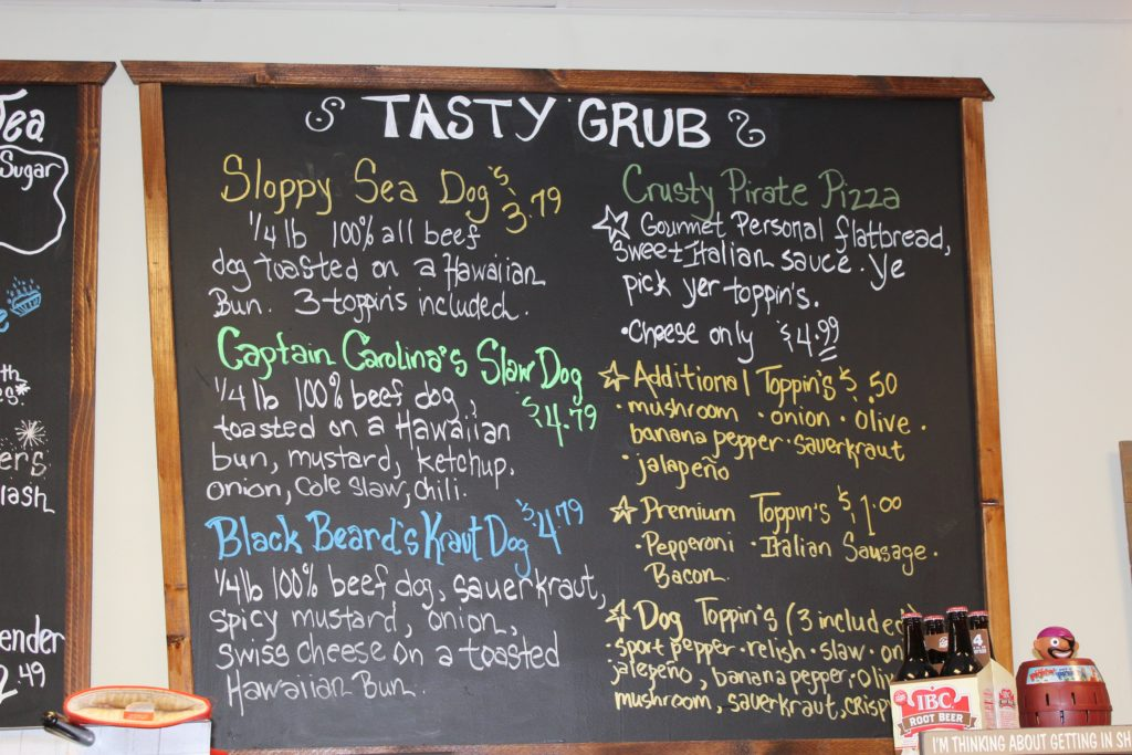 Wall chalk board menu with food items and descriptions