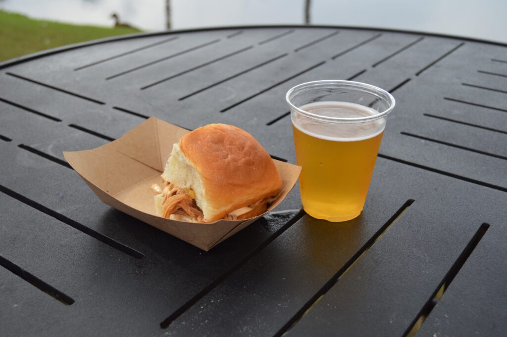 pork slider sandwich with a glass of beer