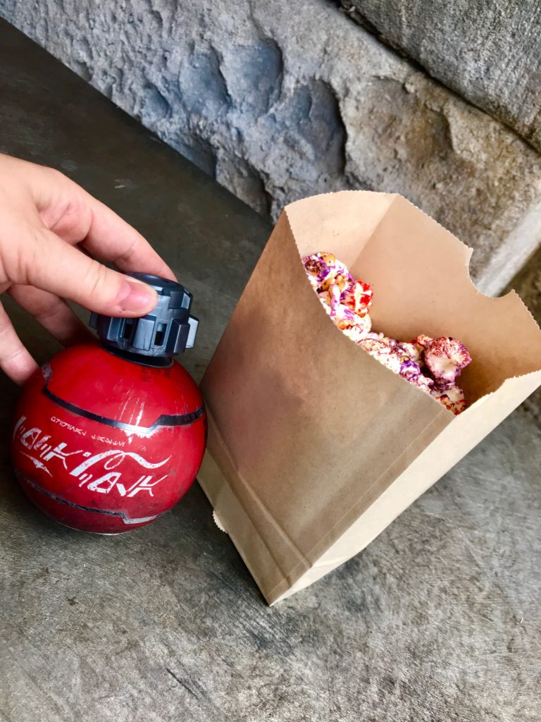 Paper bag of red and purple popcorn with Star Wars bottle of Coke