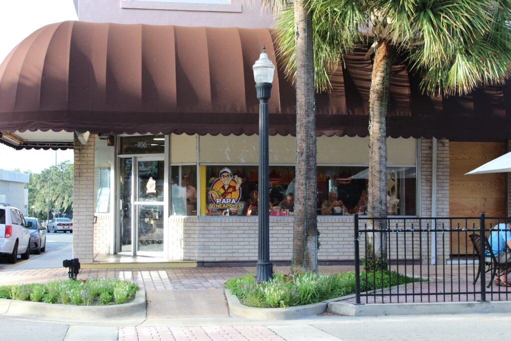 Outside view of Papa Pineapples restaurant on corner in Leesburg