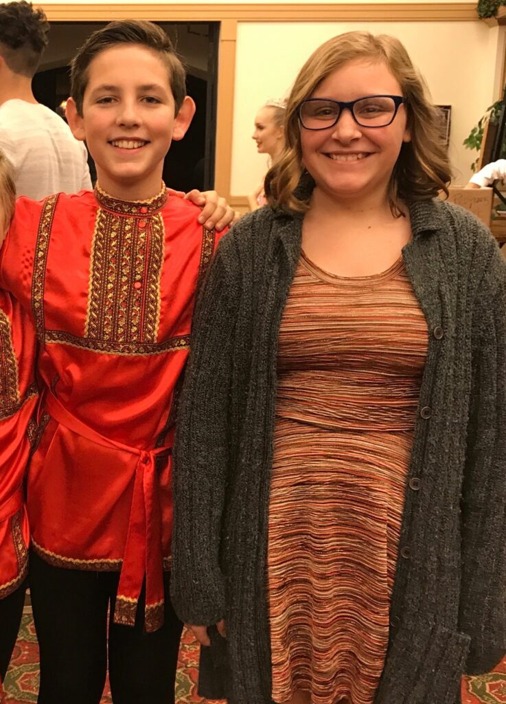 Teen boy as Russian dancer with teen girl at Mount Dora School of Ballet Nutcracker