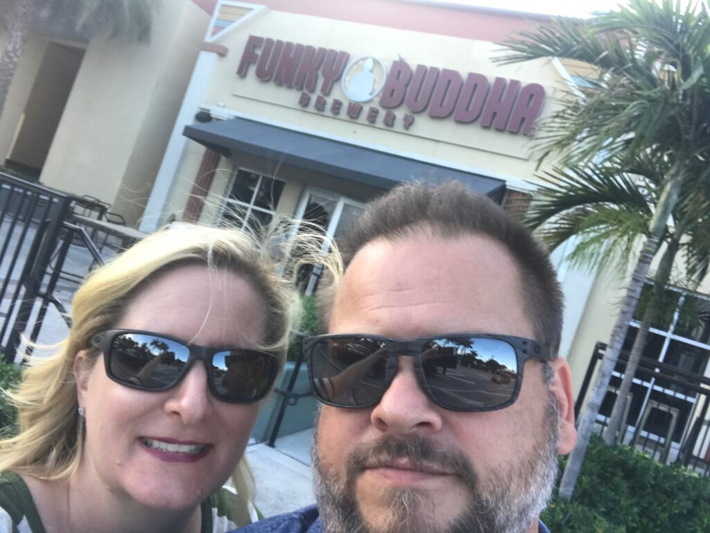 Couple in front of Funky Buddha Brewery