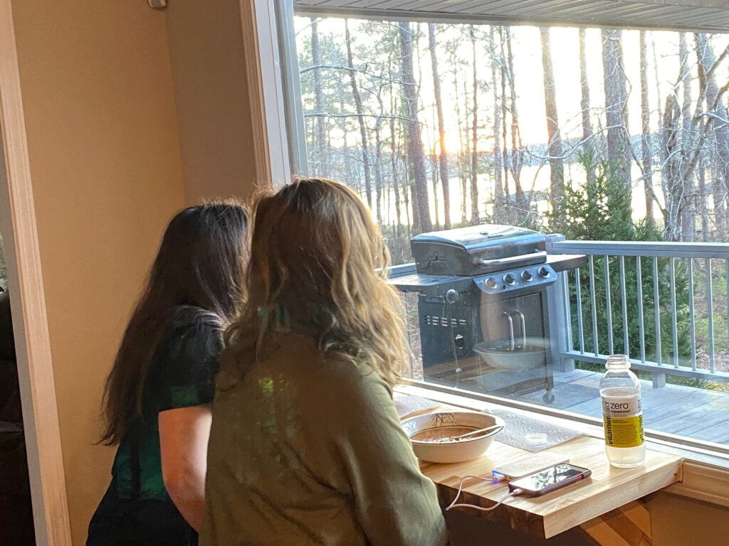 Girls sitting in dining room window seats at Southern Water's Retreat