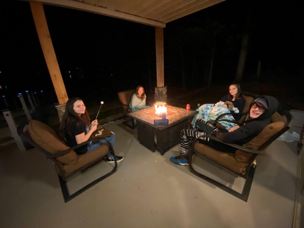 Teens roasting marshmallows at Southern Water's Retreat