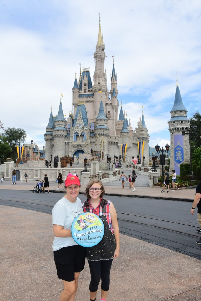 Mom and daughter in front of Cinderella Castle