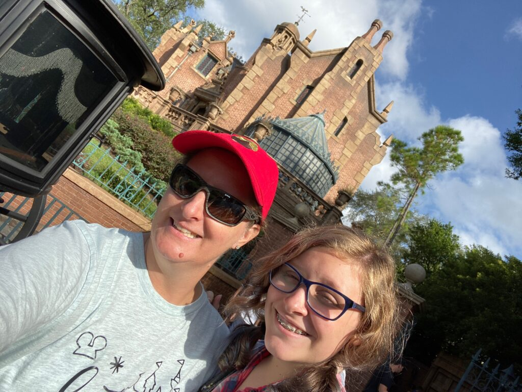 Magic Kingdom Original Attraction Haunted Mansion with mom and daughter in front