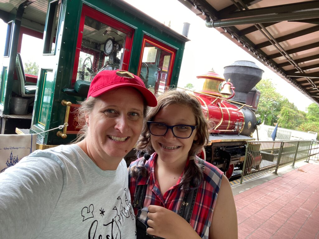 WDW Railroad with mom and daughter in front