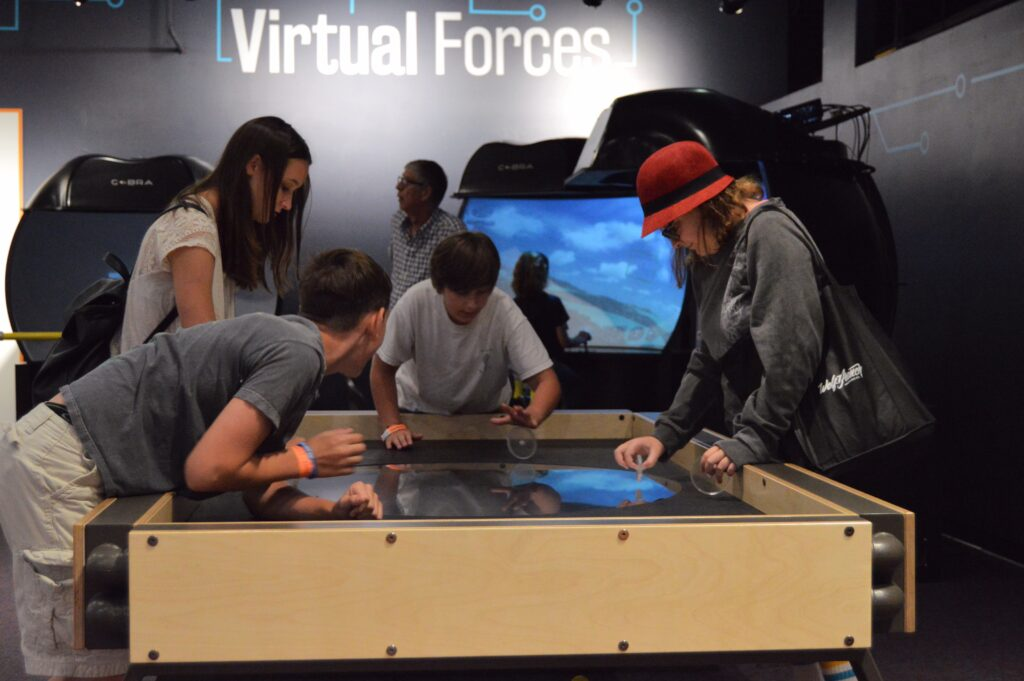 Kids playing with interactive exhibit in Orlando Science Center