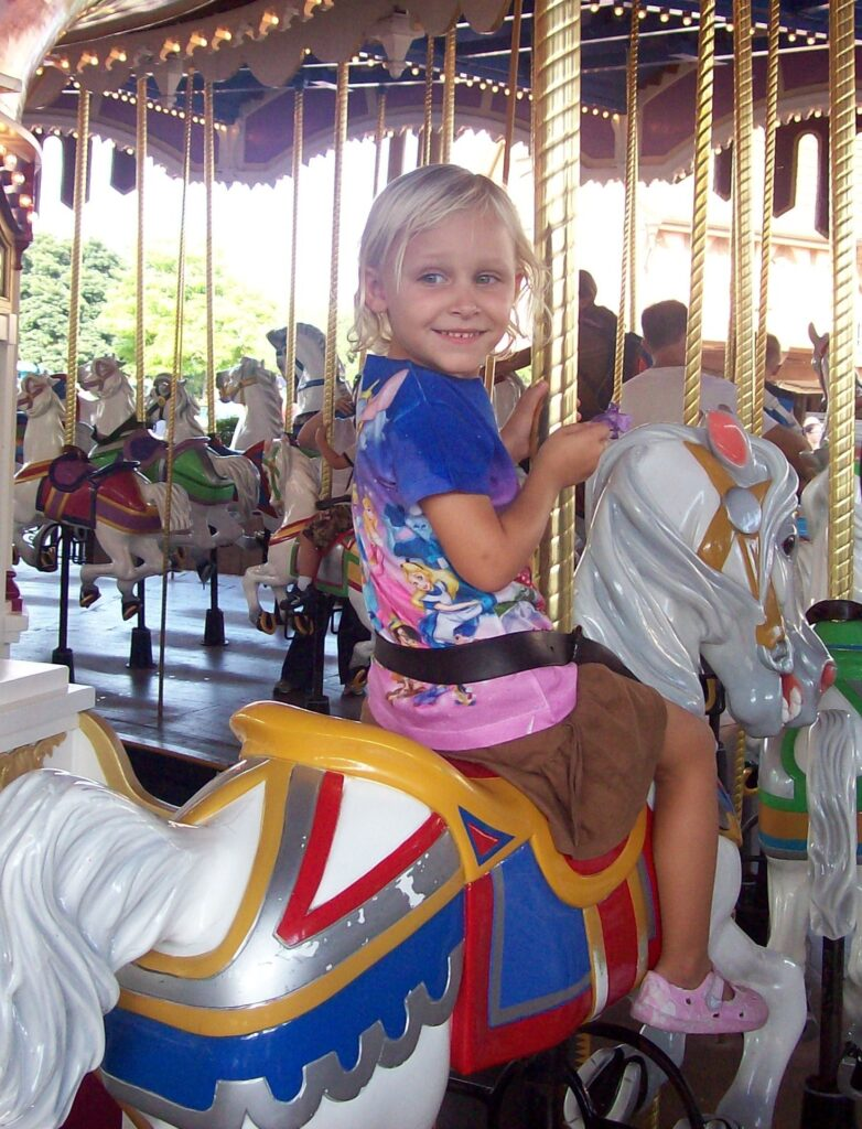 Magic Kingdom Original Attraction Prince Charming's Carrousel with toddler