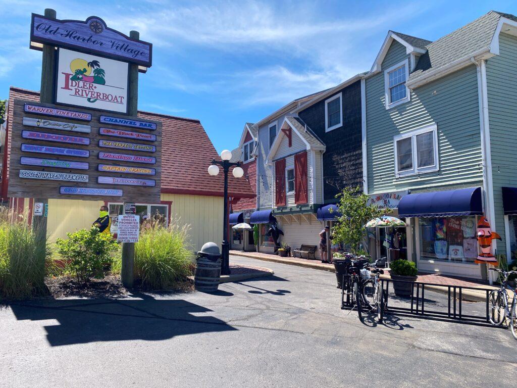 Old Harbor Village shops & sign