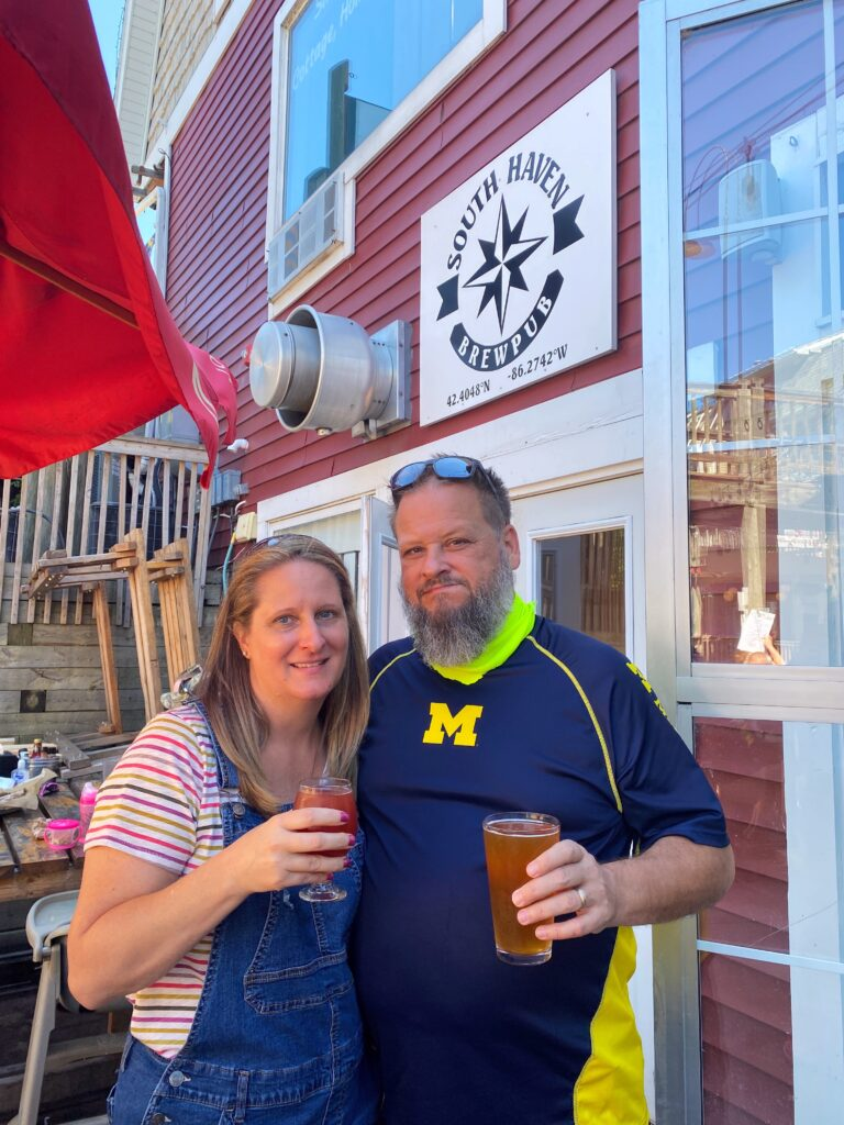 Couple with beer outside South Haven Brewpub