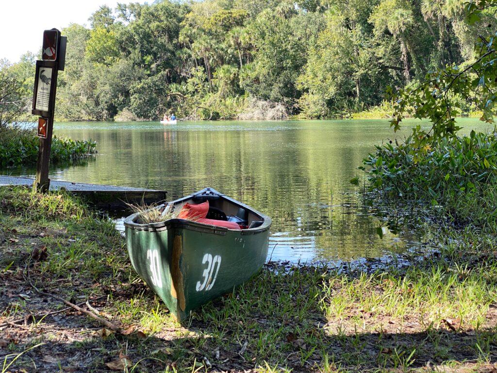 canoe on edge of water