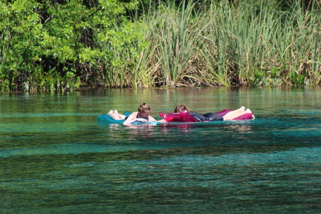 girls floating in Alexander Springs