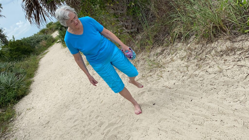 woman walking in sad in New Smyrna
