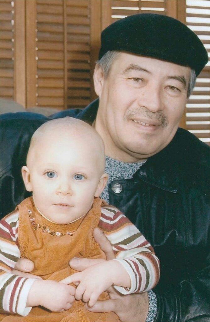 Man holding baby girl