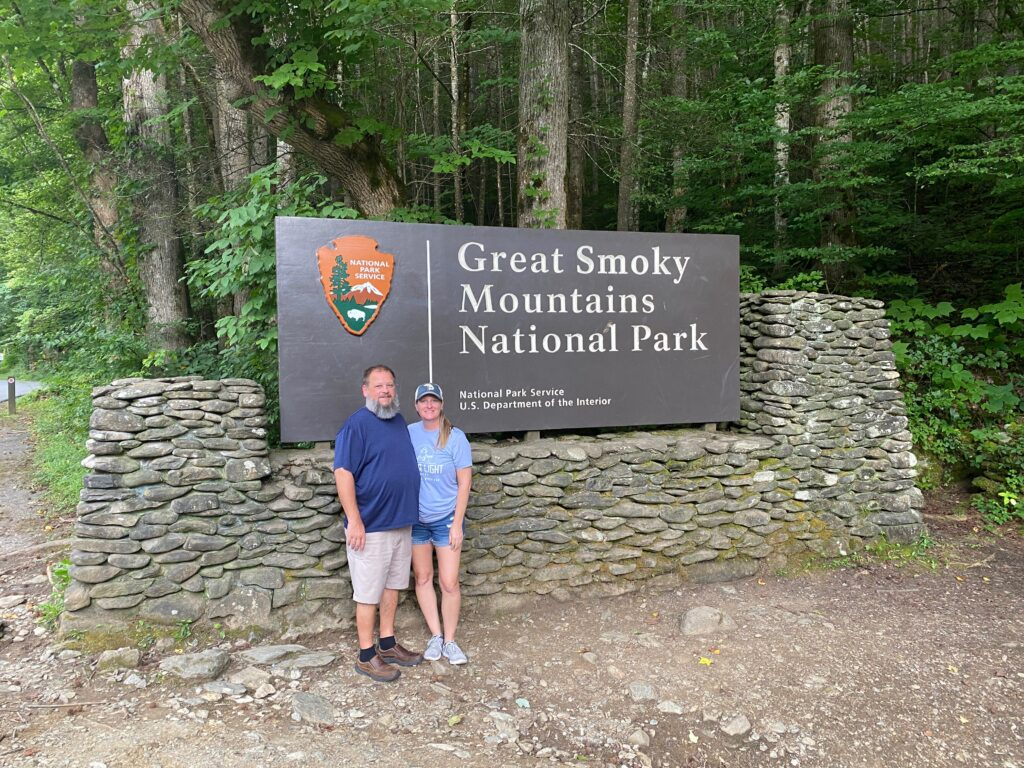 Couple in front of Smoky Mountain National Park sign