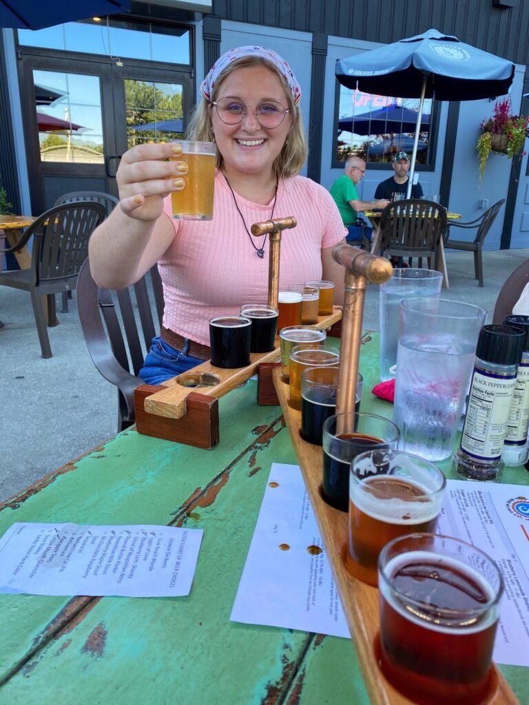 Girl with beer flight at Saugatuck Brewing