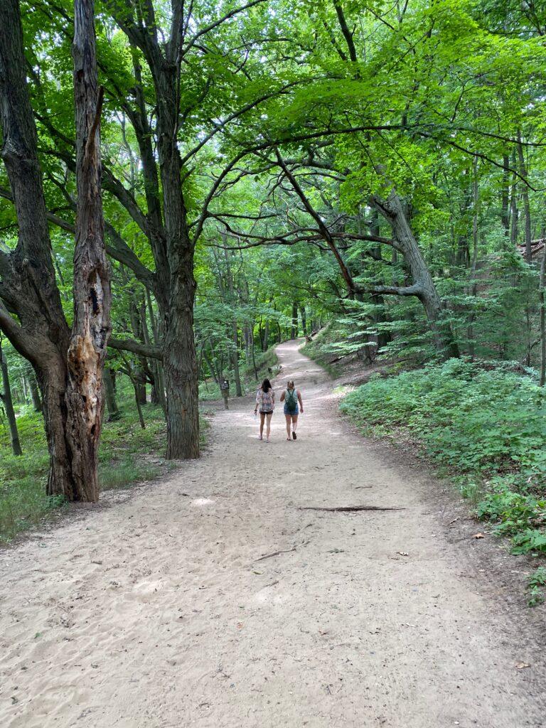 Girls walking trail in Saugatuck Dunes State Park