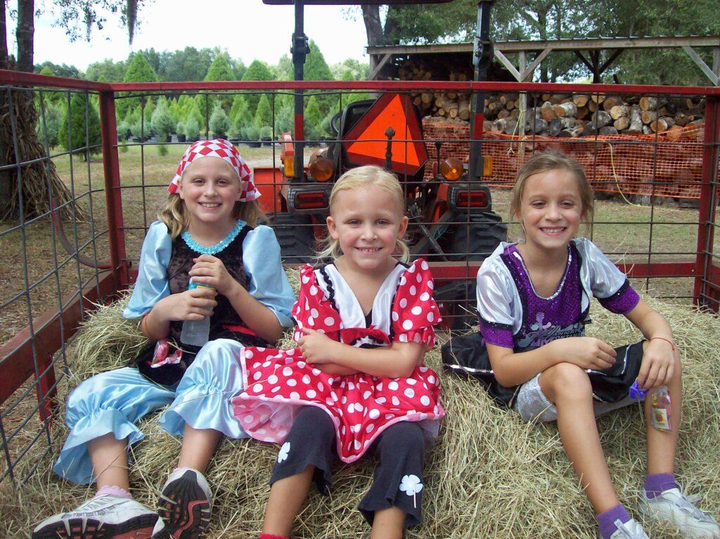 Girls on hayride at Santa's Farm
