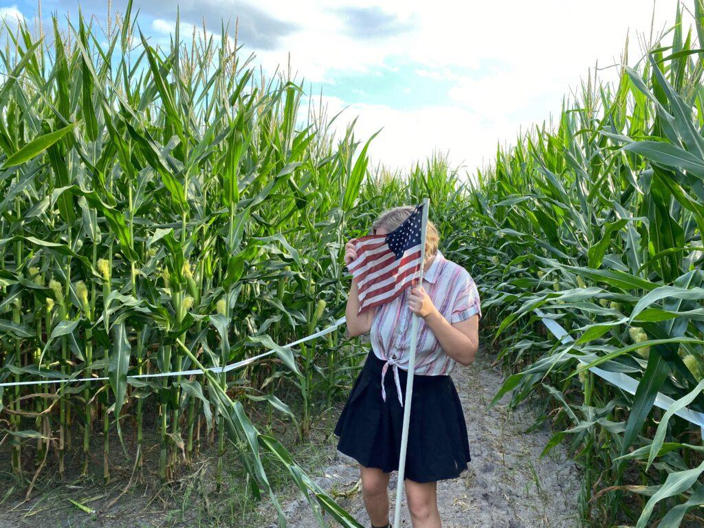 Holding flag in corn maze
